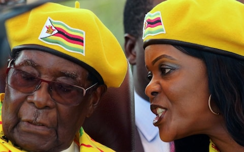 Grace Mugabe talks to the President during rally