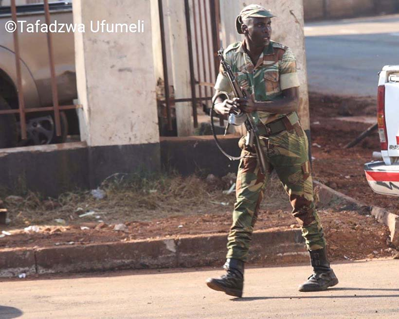Zimbabwe soldier with AK47 during protests