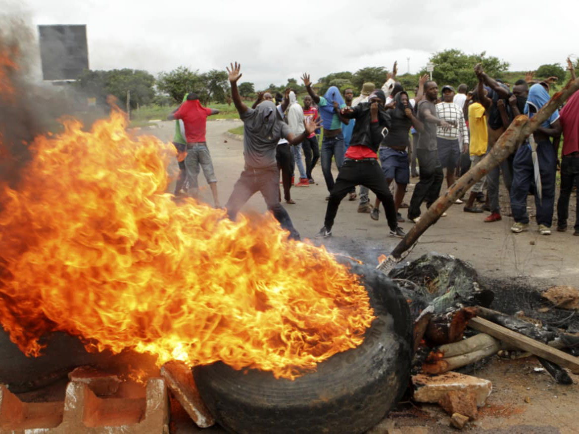 Protestors light fires during unrest in Zimbabwe