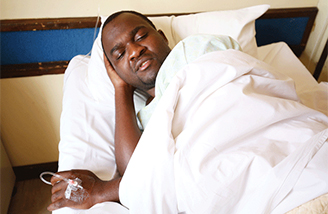 Patson Dzamara recovering in hospital after abduction and torture in Zimbabwe before a protest against the issue of bond notes