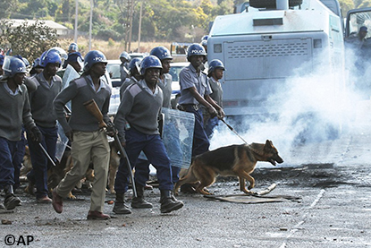 Riot police with teargas and dogs break up legal protests in Zimbabwe