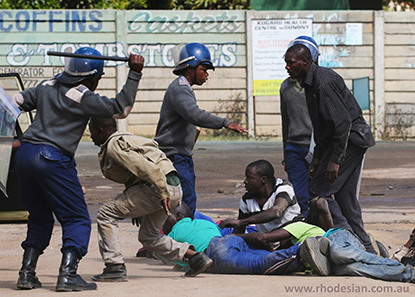 Protesters beaten by Zimbabwe riot police