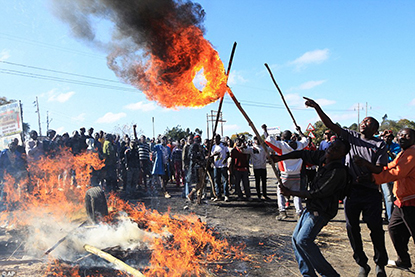 Protesters retaliate after violence against their leagl marches in Zimbabwe