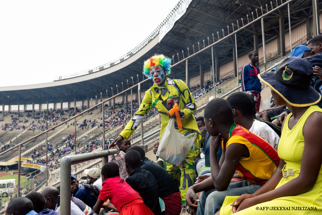 Clown sells balloons at 39th Independence Celebrations in Zimbabwe